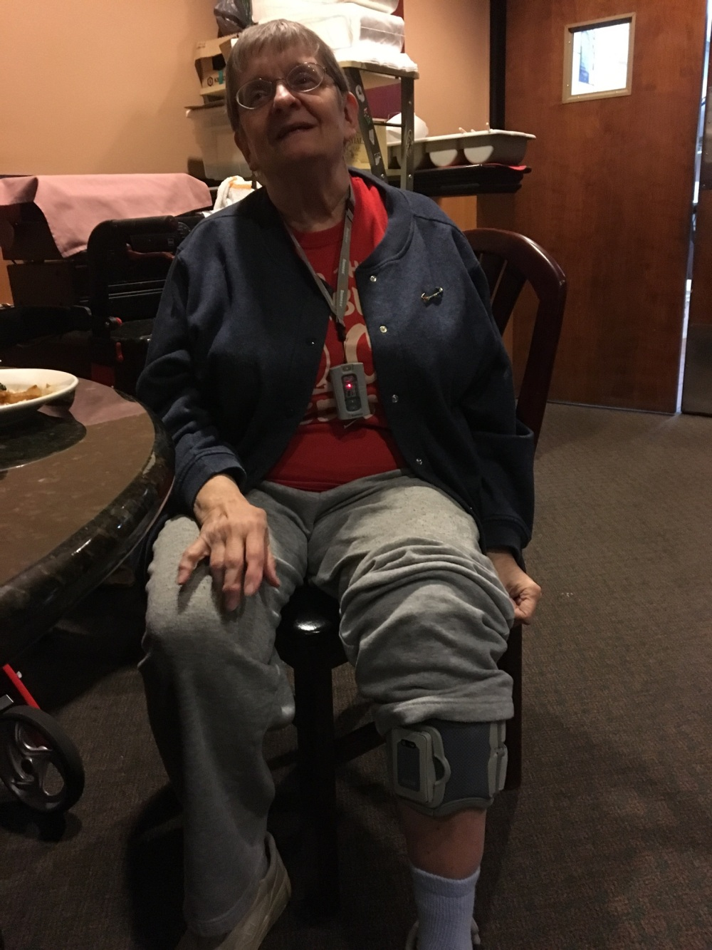 "My photo is of me sitting in a chair with my pant leg pulled up to show my new ""bionic"" device which helps me walk."